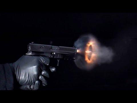 Super slow-motion video of bullets leaving a handgun