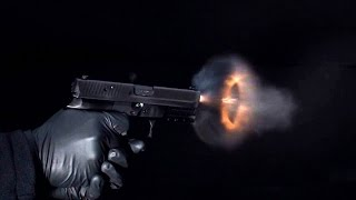 Super slow-motion video of bullets leaving a handgun