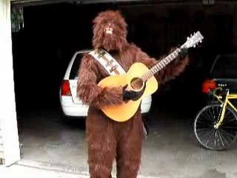 Chewbacca plays guitar and sings