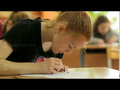 Russia, Novosibirsk, 2015: School girl at a school desk