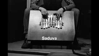 Peck Allmond, kalimba: Saduva - w/ Kenny Wollesen, bass kalimba