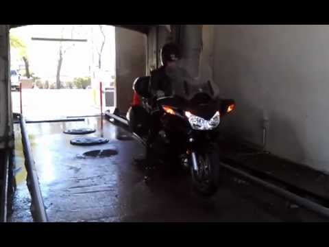 Motorcycle goes through a car wash