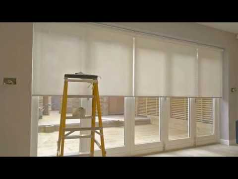 THE BLIND SHOP Sunscreen roller blinds fitting on bifold doors