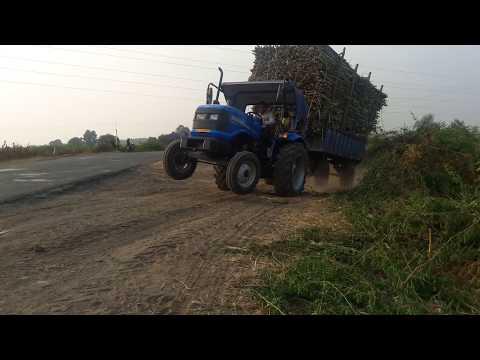 Sonalika di 47 rx pulling sugarcane trolly
