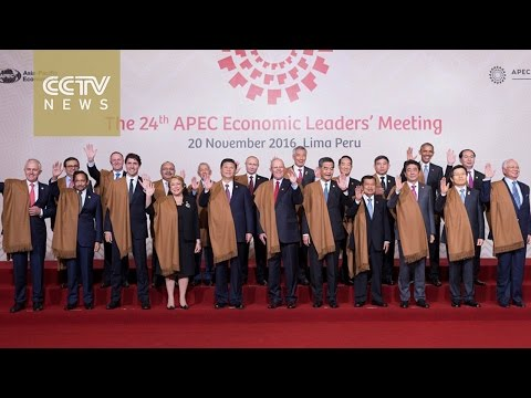 "Asia-Pacific leaders pose for a ""family photo"" at the 2016 APEC Economic Leaders' Meeting"