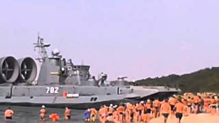 Russian Navy Hovercraft Lands On Busy Beach -  NEW