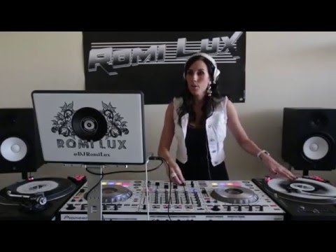 DJ Romi Lux mixing on Pioneer SZ with turntables