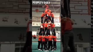 How many somersaults can you do at a time – on a three-floor human tower?