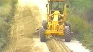 How to remove a high road shoulder with a motor grader