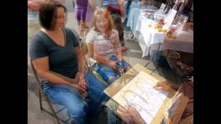 Caricature drawing by Ron Deane of RDNA Studio Gallery at Oktoberfest 2014