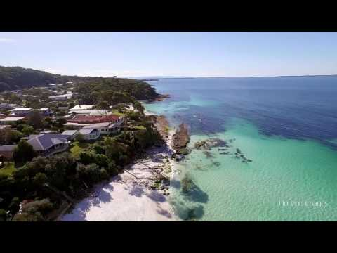 Aerial film of Hyams Beach, Jervis Bay, NSW - August 2016