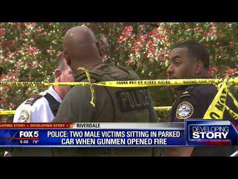 Police say 2 men shot in parked car
