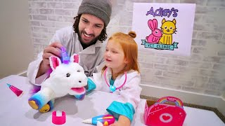 PET CLINIC ROUTINE! Doctor Adley and Dad take care of moms new unicorn with Rainglow Unicorn Vet Set