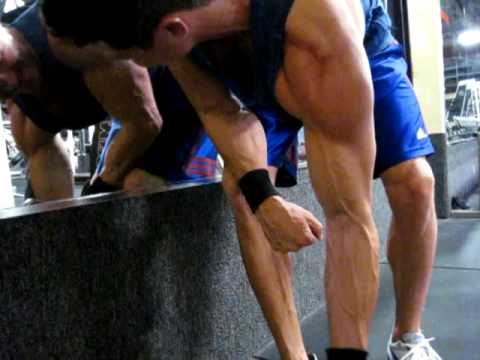 The Muscle Couple Performing DB Concentration Curls with Fat Gripz