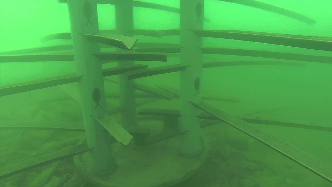 Fish hanging around artificial fish attractors at the for Pvc fish attractors