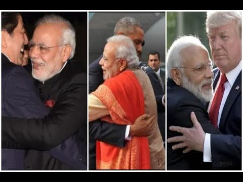 French President's mysterious smile while hugging Modi goes viral