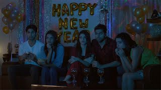 Group of male and female friends watching TV at home - New Year Celebration in India