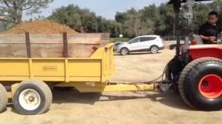 Kubota L3240 dumping