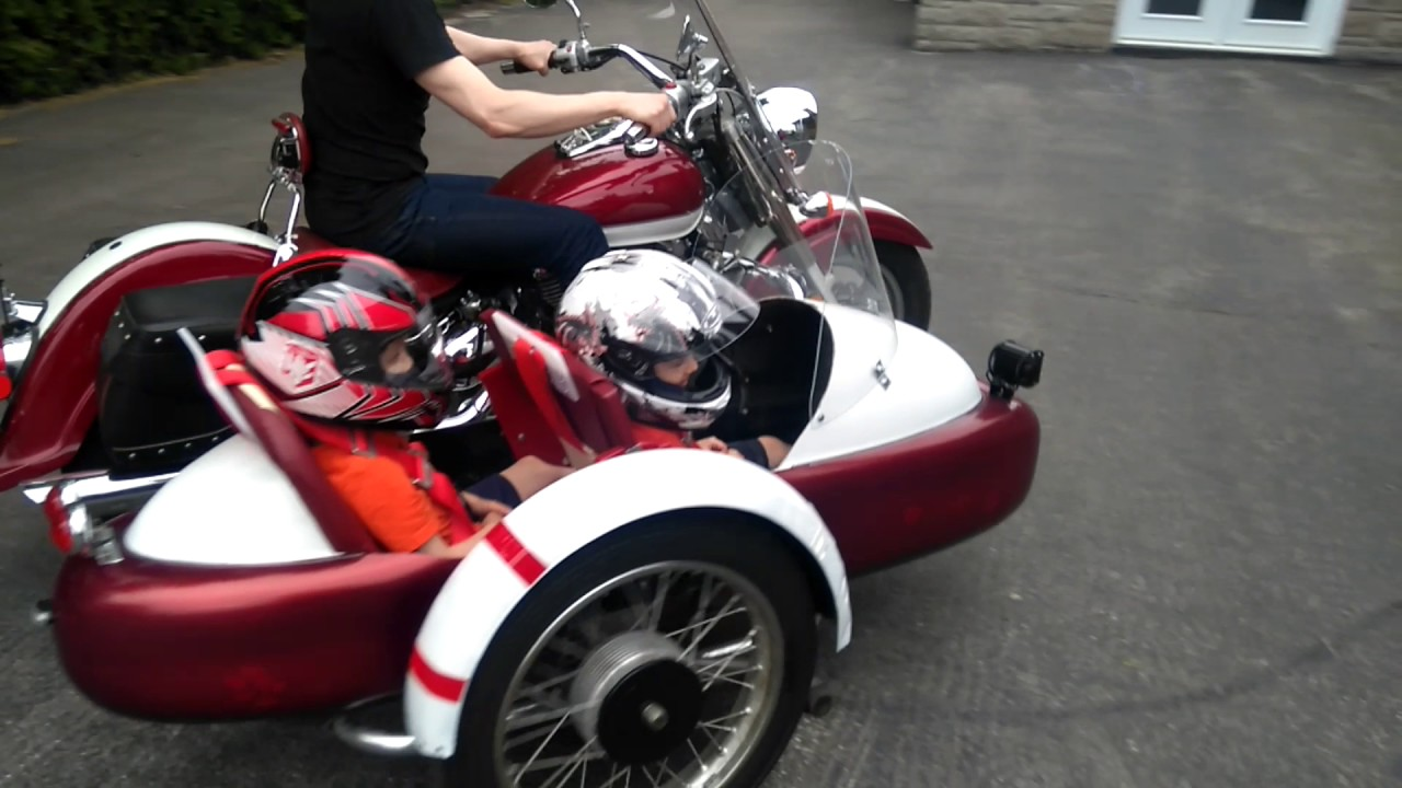 Custom motorcycle with sidecar, kids in sidecar, double sidecar
