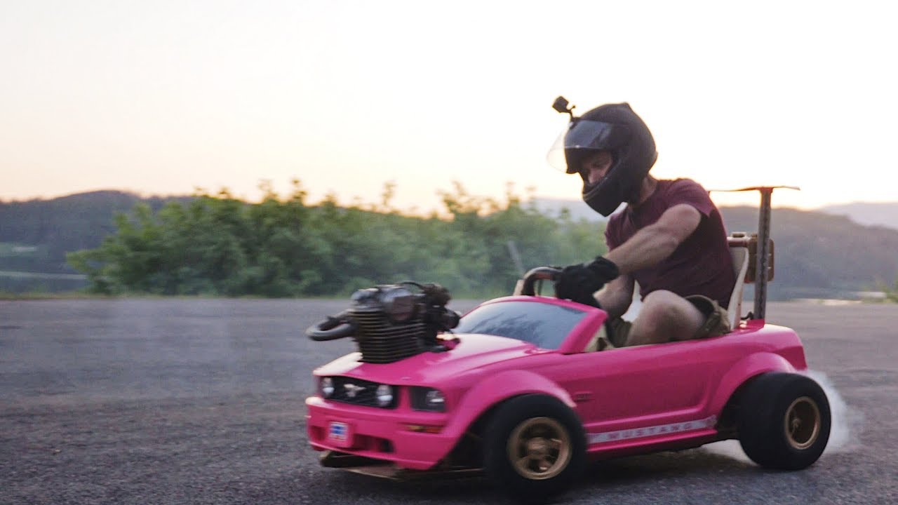 A Modified Barbie Power Wheels Mustang Go Kart With a Real