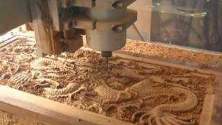 CNC Router cutting the Wood Dragon mad from hardness wood from Thailand.