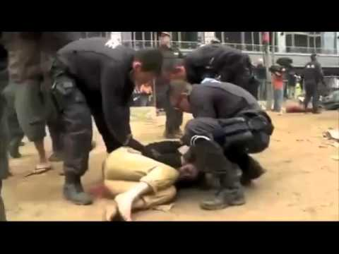 Police beat down Occupy Wall Street Hippies to the Glenn Mil (MIRROR)