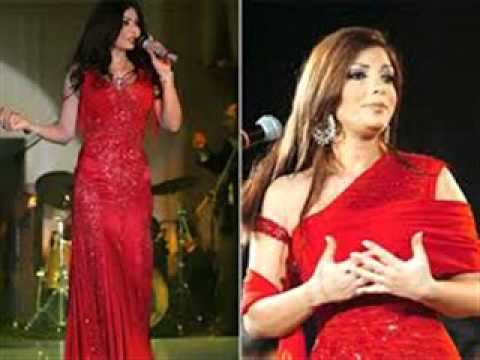 b019a4c93 شاهد اجمل اطلالات الفنانات إطلالات حمراء لعيد الحب فساتين مميزة على طريقة الفنانات  العربيات من كانت