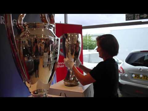 UEFA Super Cup and UEFA Champions League trophies