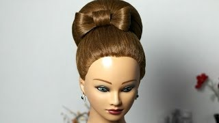 Bun with hair bow for long hair. Updo hairstyle