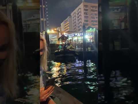 Crossing Dubai creek on an traditional abra