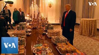 Trump Serves Burger, Fries, Pizza to Cl...