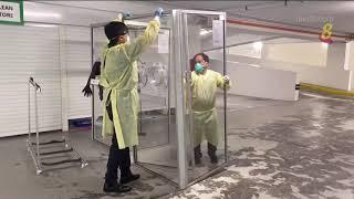 【冠状病毒19】中央医院安全检测亭 省时省防护服保护采样人员