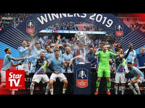 Manchester City complete historic treble