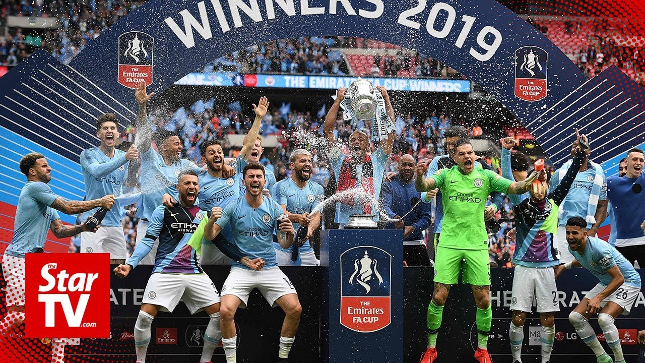 Manchester City complete historic treble