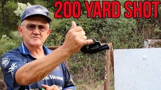 Impossible 200 Yard Snub Nose Revolver Shot- Upside Down, One Handed, With Pinky Finger