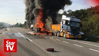Two lorries burst into flames after colliding on NSE near Slim River