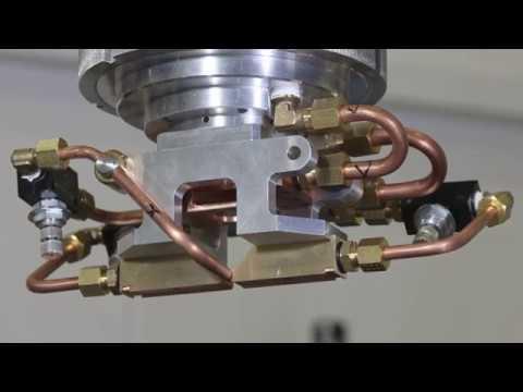 ModuLase: Development and Pilot Line Validation of a Modular Re-Configurable Laser Process Head