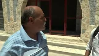 البطل منصف عامل البناء قام بضرب الارهابي على رأسه بحجر قبل القضاء عليه من قبل الأمن