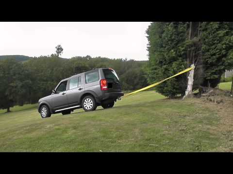 A Landrover Discovery pulling out an old tree stump