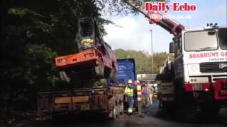 Forklift truck falls off lorry