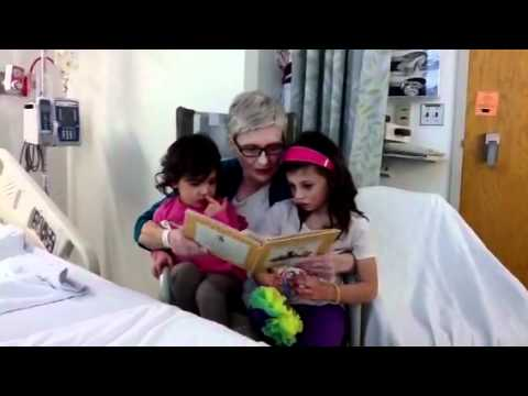Grammy reading Eeyore to Pria and Amita