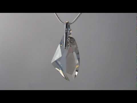 Swarovski crystal pendant set in large silver clasp dotted with swarovski crystal pendant set in large silver clasp dotted with cubic zirconia stones aloadofball Gallery