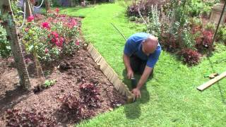 How To Install Log Roll Edging | Forest Garden & Howarth Timber