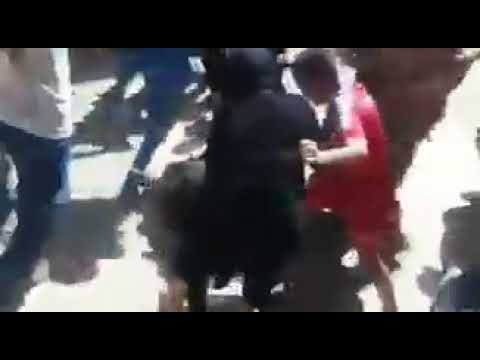 People beating ISIL fighter Yarmouk Damascus Syria
