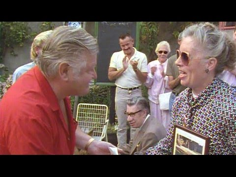 Benny Hill presents money to the Guide Dogs Association at the Kings Head (1991)