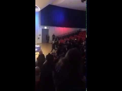 Crowd of students at Brunel University attend speech from Katie Hopkins, stand up and turn away from her when she begins to speak