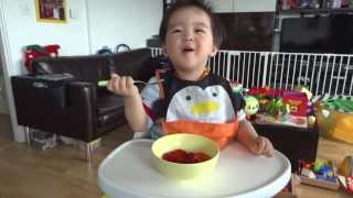 Baby Benjamin munching on strawberries