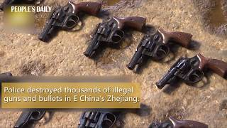 Police destroyed thousands of illegal guns and bullets in E China's Zhejiang.