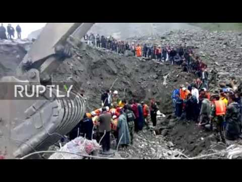 China: More than 140 feared buried under rubble after Sichuan landslide