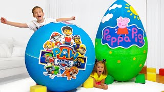 Max and Katy unboxing toys from Paw and Pig surprise eggs